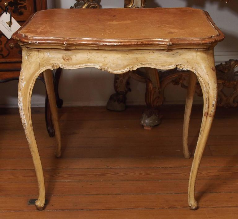 Italian painted Louis XV style table with leather top.