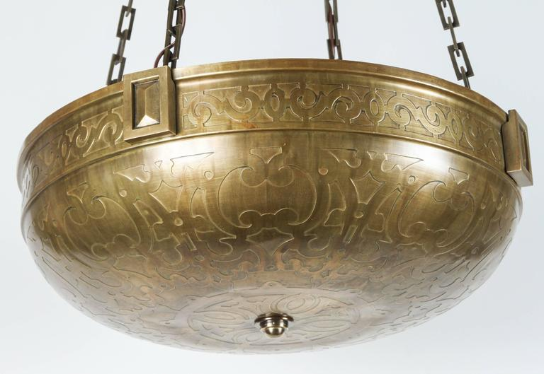 A larger Moorish-style early 20th century acid-etched brass bowl fixture. Exceptional quality. Measures 19.5in diameter.  New electrical up-lit four (4) Edison base, new chain and canopy. Total drop height is 43 inches.