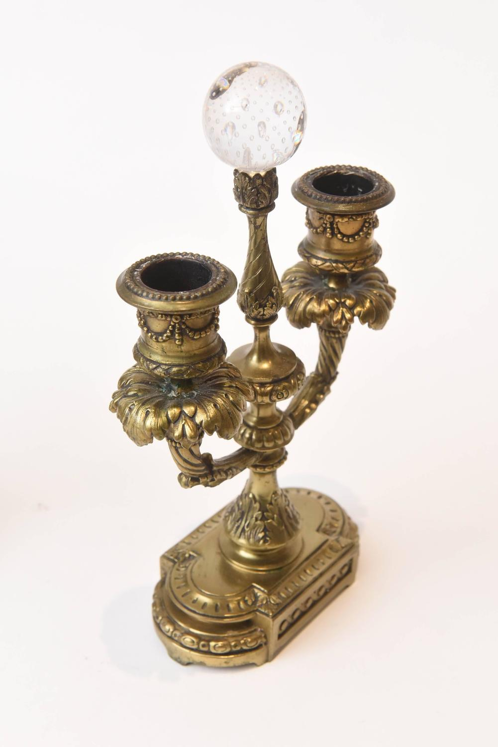 Elaborate gilt metal and glass three piece garniture