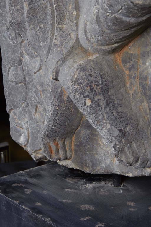 Carved boddhisattva in black limestone for sale at stdibs