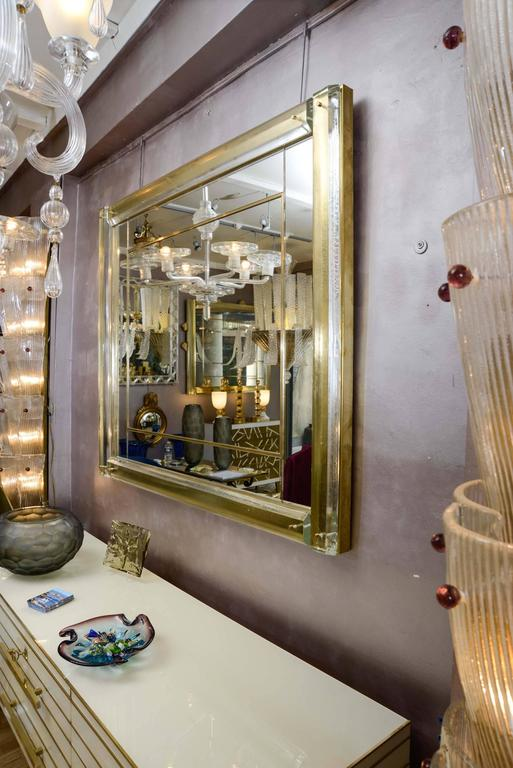 Brass Mirror surrounded with Murano glass.