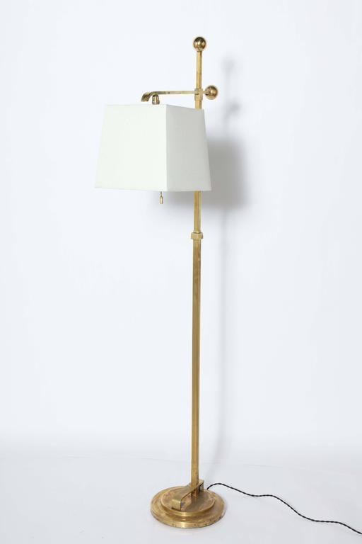 Rare, Art Deco, Donald Deskey Brass Reading Floor Lamp by Deskey-Vollmer Inc. The Brass Standing Lamp features a new square Off-White Linen Shade measuring (8W x 9.5 W x 9H) on round base. Ball Socket. Vintage distressed finish.Lightly restored.