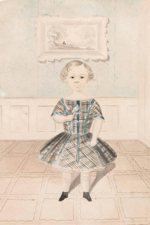 A lovely English antique watercolor of a young girl wearing a plaid dress of the mid-19th century and facing front for her portrait. She holds up two roses. The patterned floor, the wainscotted wall, the large painting on the wall just behind her,