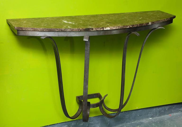 A, 1930s, French Art Deco hand-wrought iron and marble console.