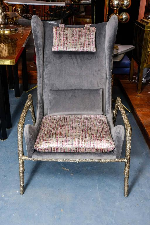 Pair of Italian style armchairs with solid bronze feet.