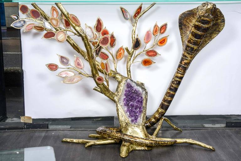 One of a kind console with amethyst and agate showing a snake around a tree signed.