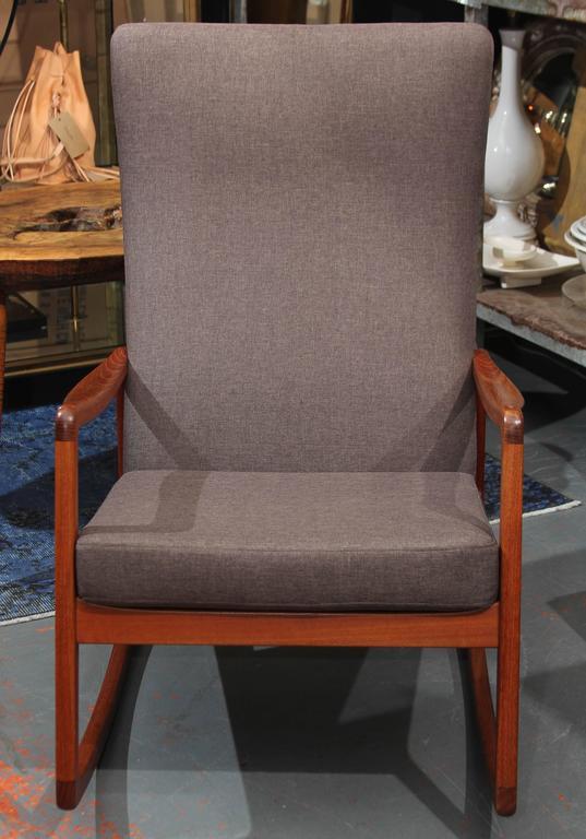 Rocker in grey linen blend upholstery.