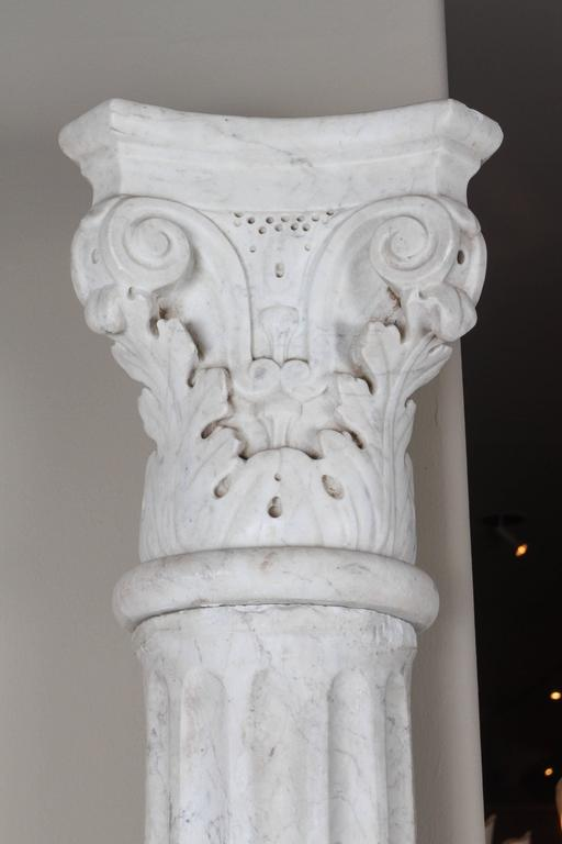 Pair of extraordinary early 19th century carved marble columns, beautifully proportioned and intricately carved. Each column is in four pieces - base, column, disc and capital.