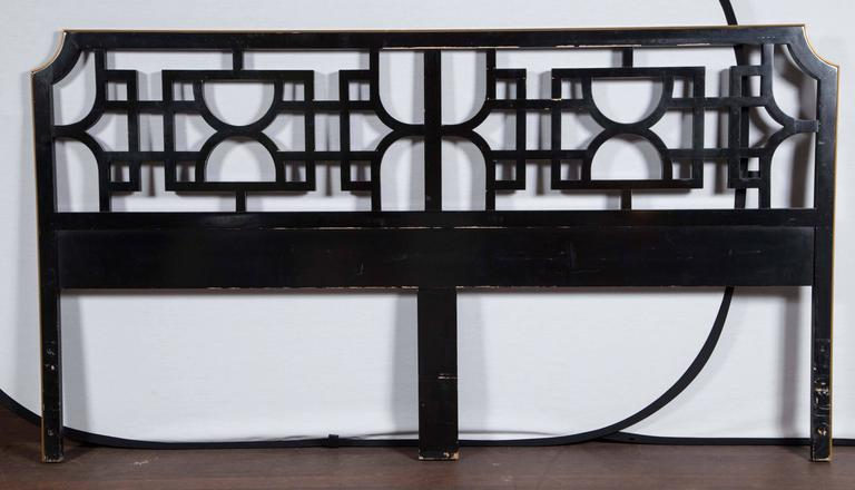 Black lacquer and gilt trim lattice, solid wood king-size headboard. Paint finish has wear, but a high quality and substantial piece.