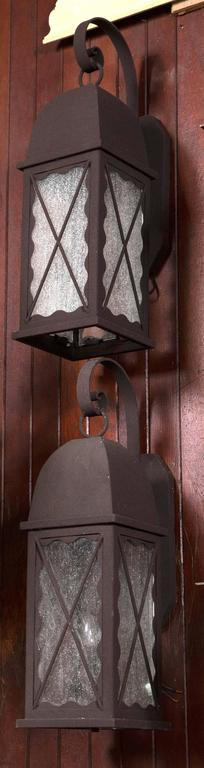 Pair of Iron Exterior Lantern Sconces In Excellent Condition For Sale In Stamford, CT