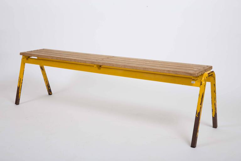 Slatted wood top, yellow metal frame.