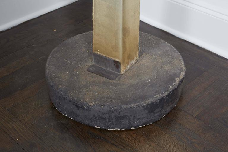 Guy Lartiques, Sculpture in cut and welded metal, cement base .  Signed: Guy Lartique 73