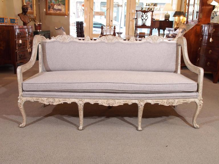 Antique French Rococo grissaile sofa.