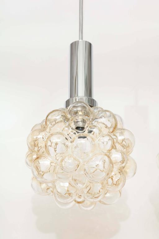 """Light champagne colored art glass pendant suspended from adjustable silver silk cord, with polished nickel canopies and collar. Each pendant houses one bulb and has 36"""" of adjustable cord. Glass measures 6"""" T x 6"""" W.  From chromed"""