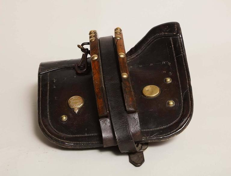 Unusual Irish 19th century specialty pony saddle with center harness by Rafferty of Dublin, in richly patinated leather, brass and timber and with padded ticking to the underside.