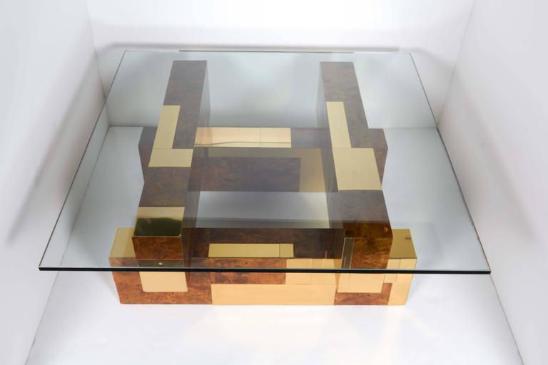 Architectural coffee table from the Cityscape Series by Paul Evans. Cubist form with rare patchwork design in burled wood veneer offset by striking brass insets. Has square glass top with polished edges.