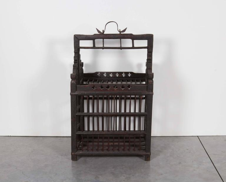 A carefully constructed 19th century Chinese birdcage with original hand-forged iron hanger. From Shanxi Province, circa 1880.