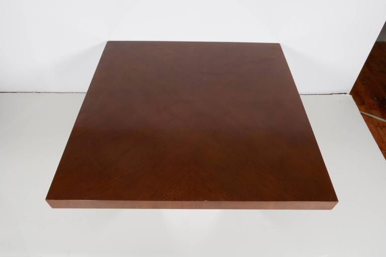 A coffee and cocktail table by Milo Baughman, produced circa 1970s with square top veneered in bookmatched walnut, over chrome pedestal base. The table remains in very good vintage condition, with presence of age appropriate wear, including minor