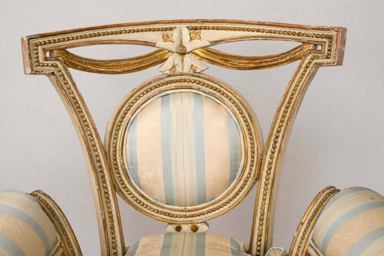 French Pair of Louis XVI Style Parcel-Gilt Upholstered Fauteuils For Sale