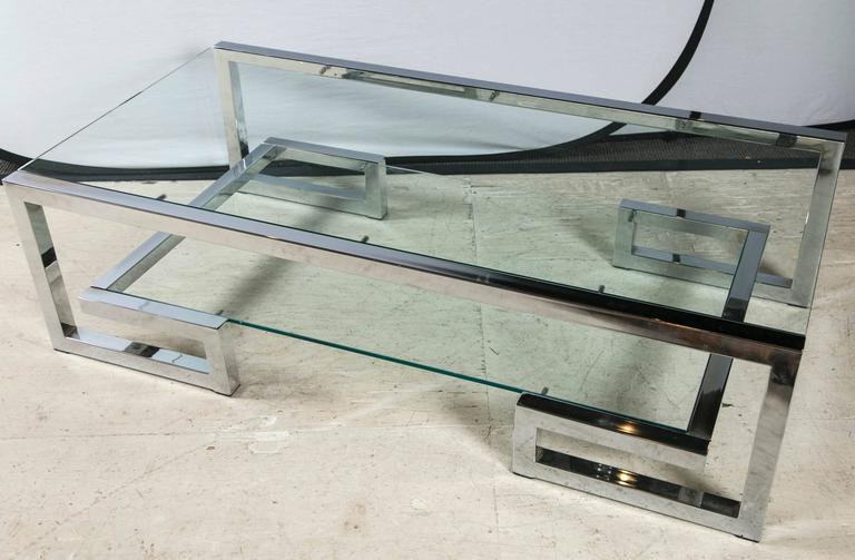 Mid-Century two-tier glass and chrome coffee table.