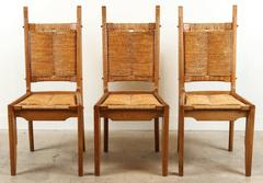 Set of Six French Oak and Rush Chairs by Maurice Pre