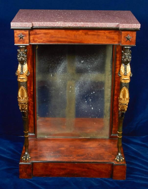 A very fine and rare pair of Regency part-ebonized mahogany gilt and patinated Bronze Console Tables in the manner of George Smith, early 1800s, circa 1810. Each side table with a Egyptian Porphory top; Each top above a conforming frieze with