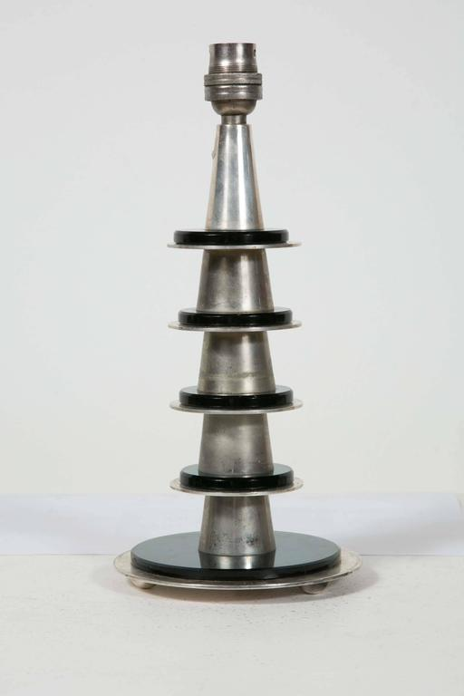 Modernist/Art Deco table lamp by Maison Desny. Nickel-plated bronze and dark green glass disks. Stamp