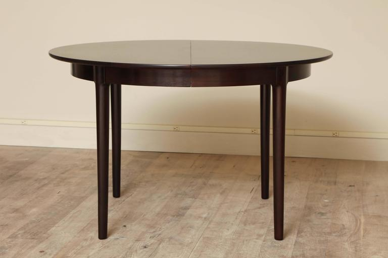 Rosewood dining table in the manner of Neils Otto Møller, circa 1960. Two, 17-3/4