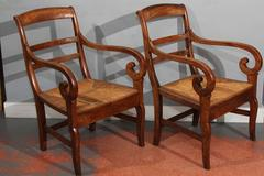 pair wood curled arm chairs