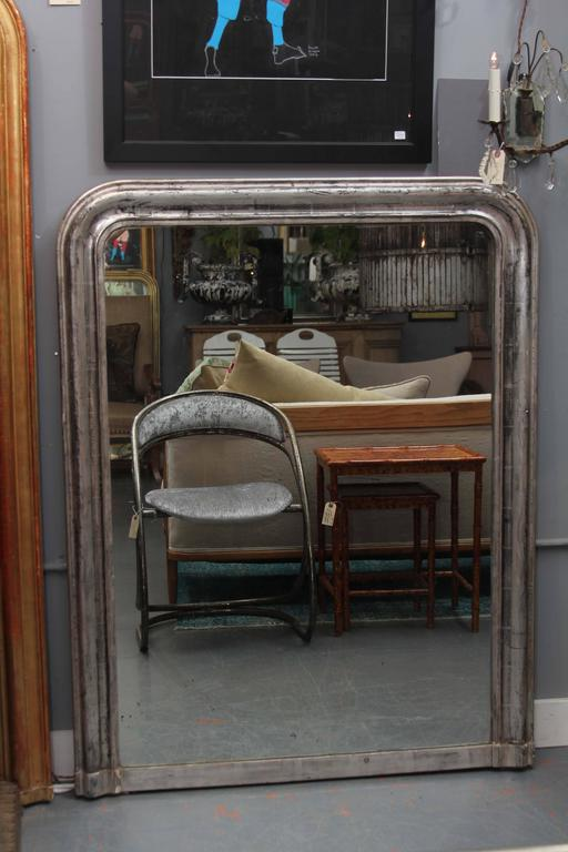 Large Louis Philippe style mirror in silver with nice black accents in finish.
