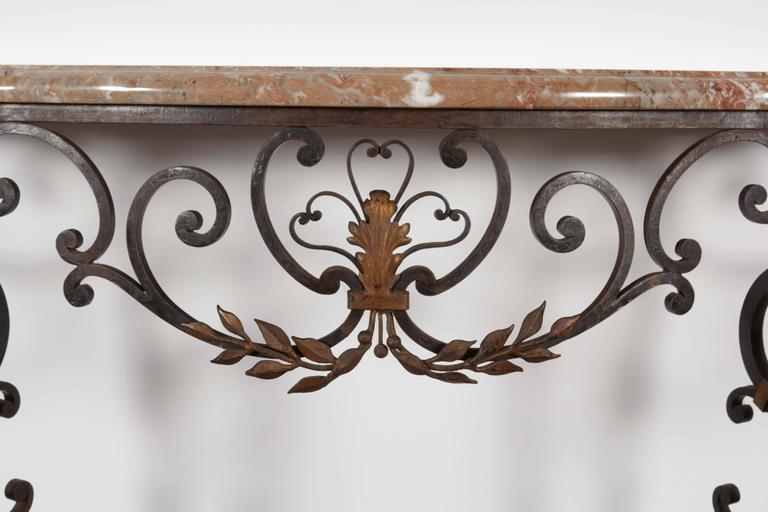 Marble top with wrought iron base demilune console.   Not available for sale or to ship in the state of California.