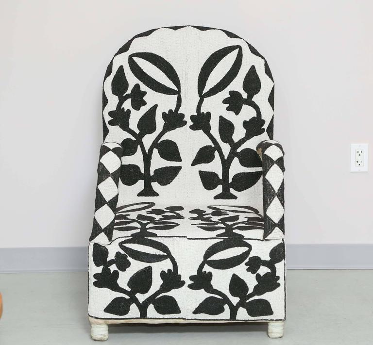Extensive bead work, black and white plant motive