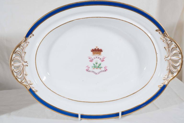 An attractive pair of oval dishes with gilded handles, royal blue borders and armorial crests with motto. The crest and motto on these dishes belongs to the Family of Perceval of Temple house, Sligo. Motto: YVERY-Sub CRUCE CANDIDA