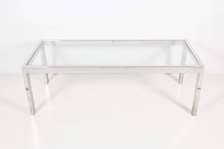 A modernist style coffee and cocktail table, produced circa 1970s, with rectilinear chrome frame and glass top inset. Very good vintage condition, wear to metal consistent with age and use.  10362
