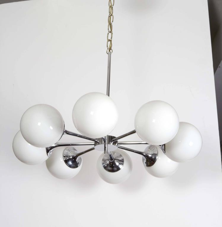 Mid-20th Century Pair of Lightolier Glass Globe Chandeliers in Chrome For Sale