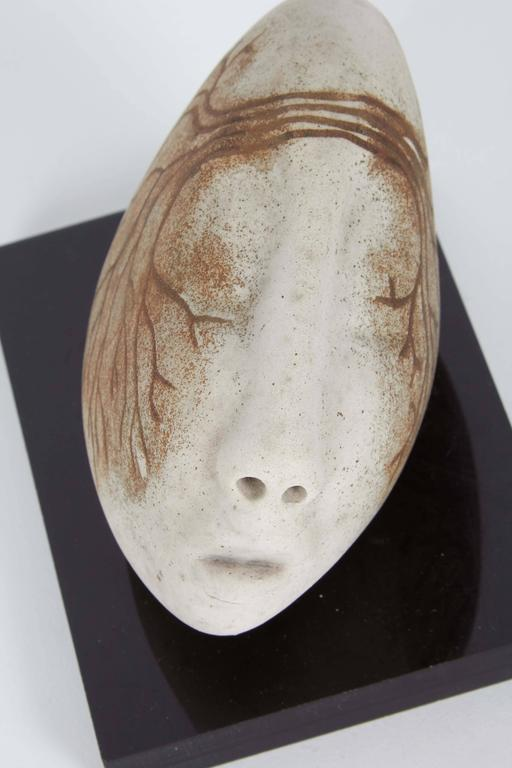 Abstract Ceramic Sculpture Of Head Mounted On Base For
