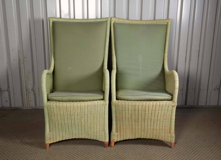 Set Of Two High Back Wicker Chairs.