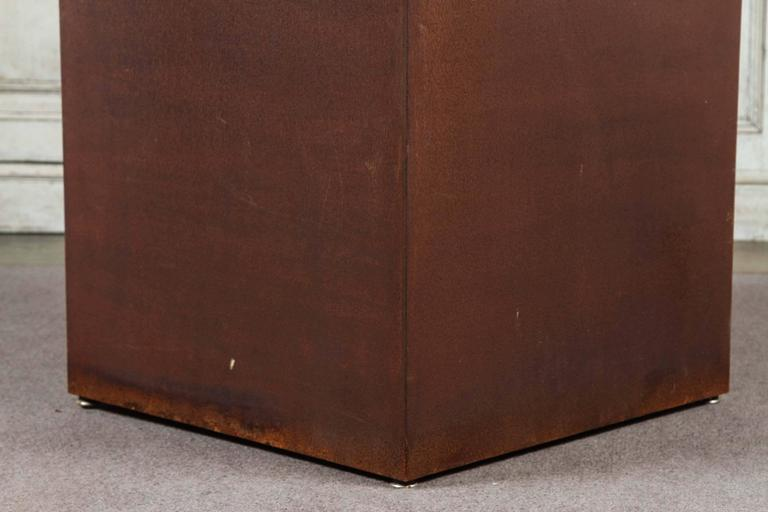 Custom metal square plinth with a rusted patina by Lee Stanton. Metal pedestal in modern form available in three heights: 20 inches, 26 inches and 32 inches. Other finishes available.