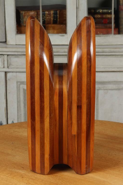 A custom wooden sculpture by Cuban artist Cervino.