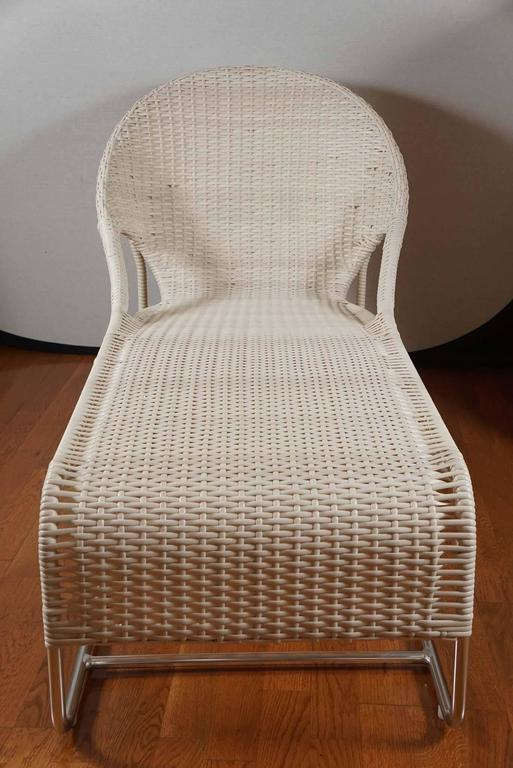 Woven chaise with hooped back and open sides. Updated for the outdoors. Shown in white polypropylene on a brushed aluminum frame. Also available in natural and blue and white striped polypropylene.