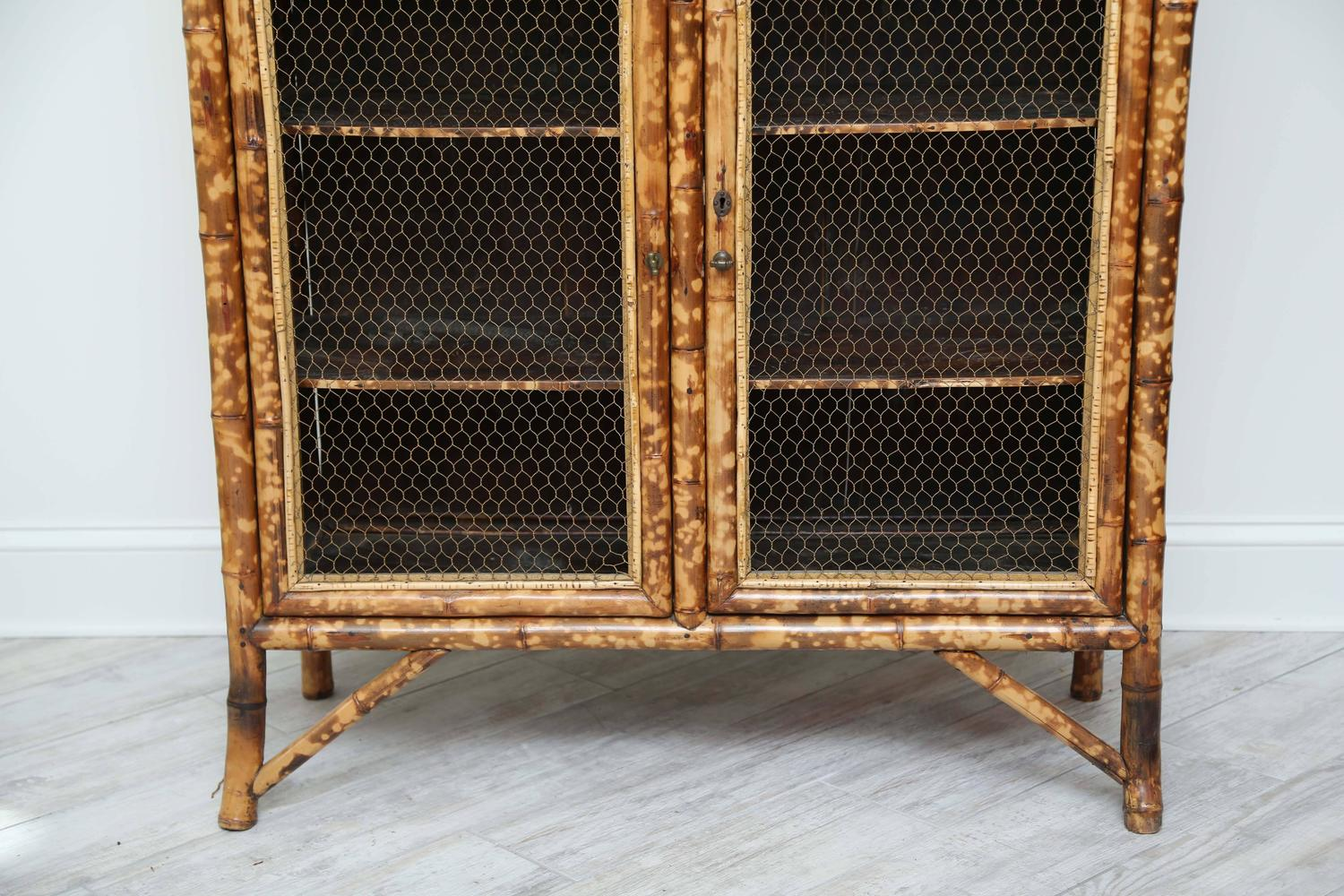 Antique bamboo cabinet with chicken wire doors for sale at for Bamboo kitchen cabinets for sale