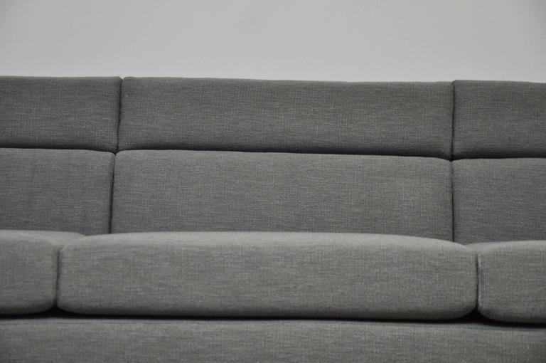 Channel sofa model 7140 designed by Roger Sprunger for Dunbar. Fully restored with new textured grey fabric.