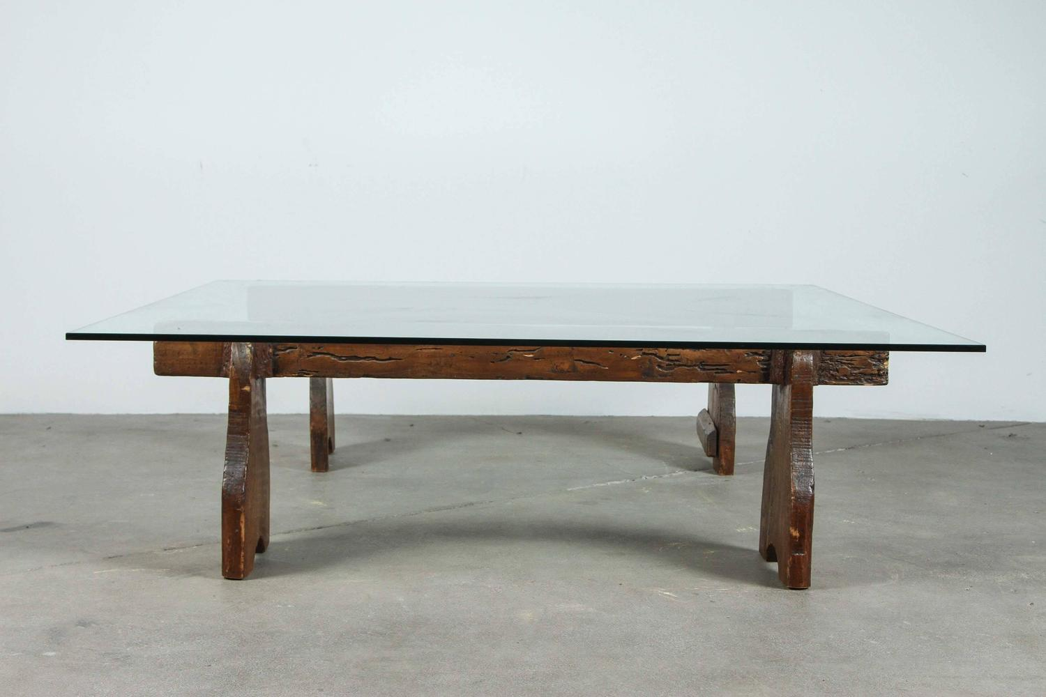 Rustic Low Cocktail Table With Wood Base And Glass Top For Sale At 1stdibs