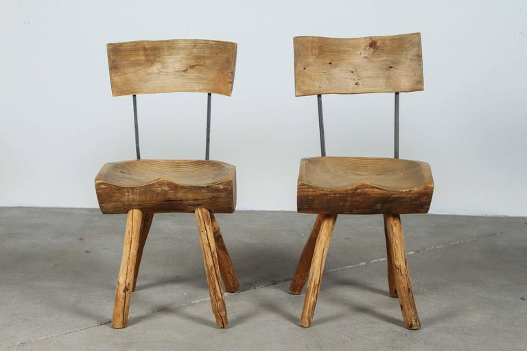 Primitive rustic log chairs.
