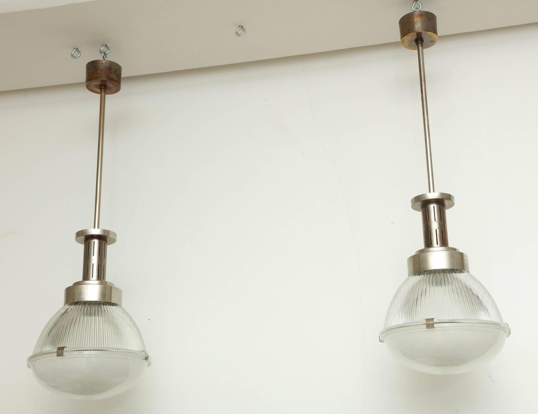 Pair of Sergio Mazza Steel and Halophane Pendant Light