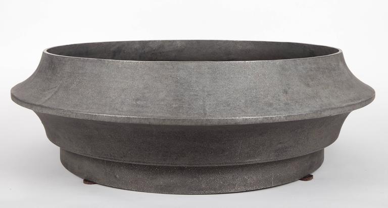 Circular low planter, aluminum.