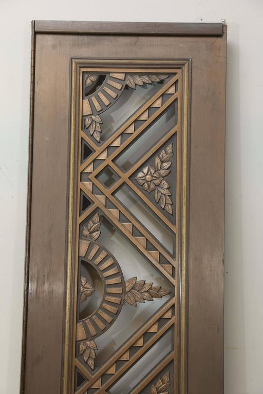 "Skillfully crafted, artist cast, bronze and copper doors,    French, 1925-1930s.  Condition is very good.   Measures: 81"" H x 19"" W."