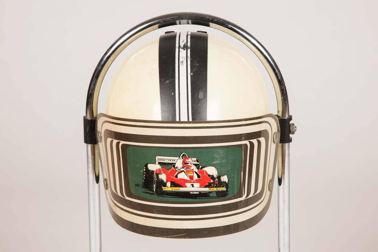 A table light in the form of a racing car drivers helmet, the visor depicts Niki Lauder driving a Ferrari Formula 1 car in the 1976 season. 