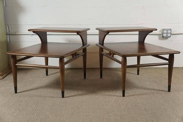 Here is a pair of newly refurbished Lane two-tiered end tables with marquetry banding. The surface on these two tables are silky and smooth.