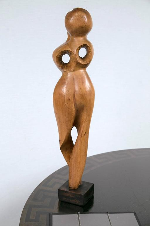 Hand-carved wood figural sculpture. Very modern and dramatic, but maintains a softness that will complement any style.